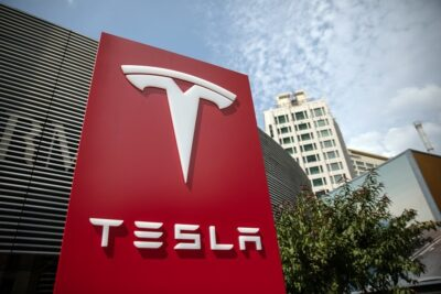 прибыль Тесла